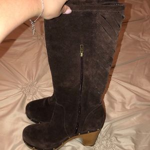 UGG suede boots with wooden studded bottoms.